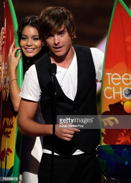 Actress Vanessa Anne Hudgens and actor Zac Efron accept the Choice TV Movie award for High School Musical 2 onstage during the 2007 Teen Choice...