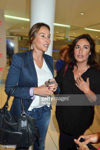 Actress Vanessa Demouy and a guest attend the Vendanges Montaigne 2012 in the Courreges Shop at Avenue Montaigne on September 11 2012 Paris France