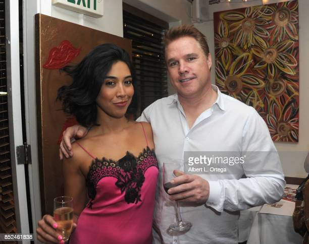 Actress Vanessa E Garcia and David Guillod attend the Vanessa E Garcia's Art Show with partial proceeds going to House of Ruth based in East Los...