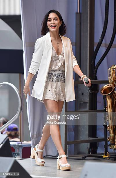 Actress Vanessa Hudgens walks out on stage at the #StarsInTheAlley Outdoor Concert Featuring Darren Criss at Shubert Alley on May 27 2015 in New York...