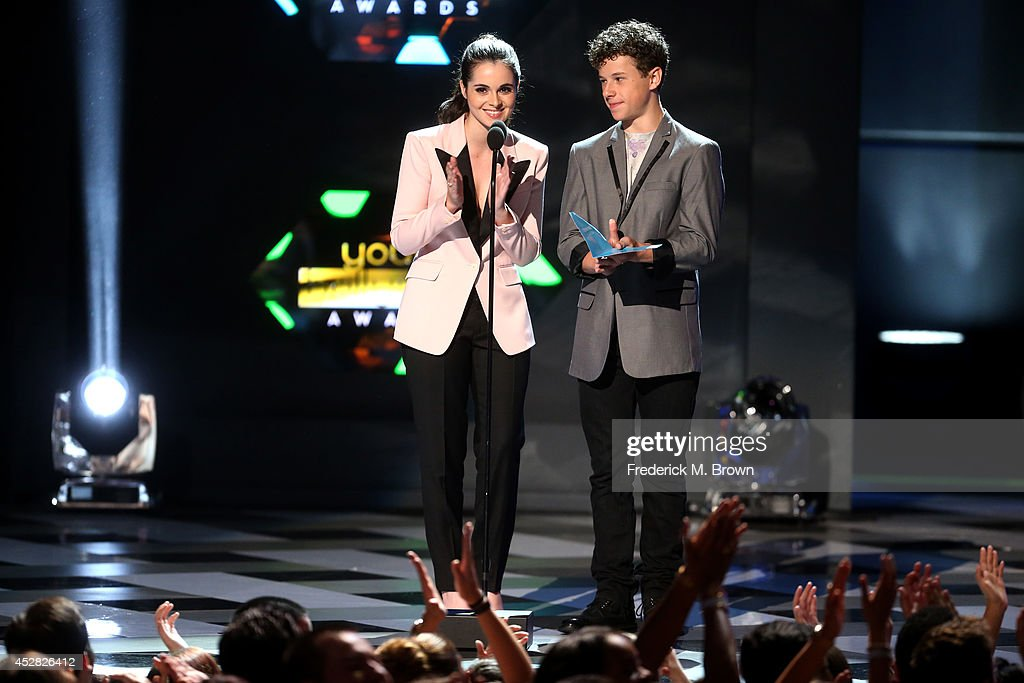 Actress Vanessa Marano (L) and Nolan Gould speak onstage at the 2014 Young Hollywood Awards brought to you by Samsung Galaxy at The Wiltern on July 27, 2014 in Los Angeles, California. The Young Hollywood Awards will air on Monday, July 28 8/7c on The CW.