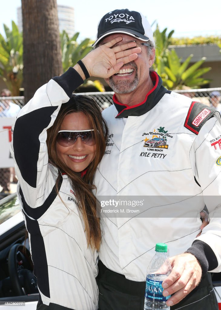 Actress Vanessa Marcil (L) and race car driver Kyle Petty attend the qualifying segment of the 37th Annual Toyota Pro/Celebrity Race on April 11, 2014 in Long Beach, California.