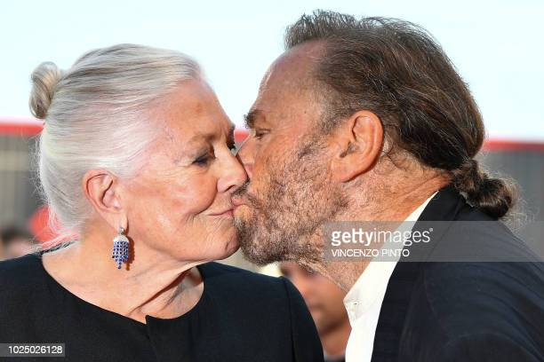Actress Vanessa Redgrave and her husband actor Franco Nero kiss as they arrive for the opening ceremony of the 75th Venice Film Festival on August 29...
