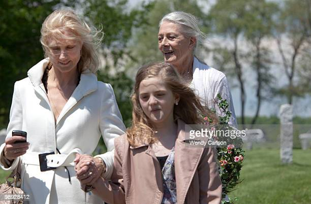 Actress Vanessa Redgrave walks with her daughter actress Joely Richardson and granddaughter Daisy at the funeral service for her sister actress Lynn...