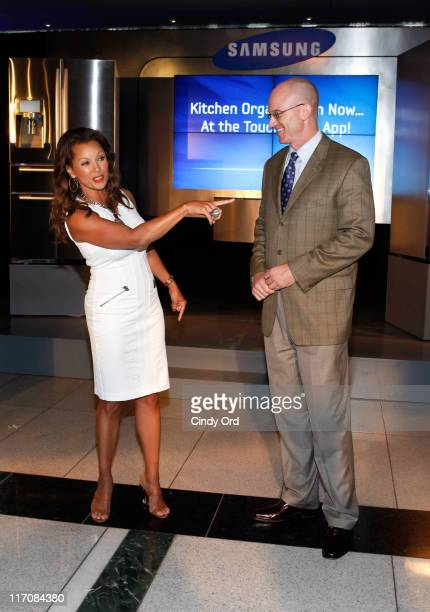 Actress Vanessa Williams and Samsung Senior Vice President of Home Appliances Kevin Dexter attend the Samsung Touchscreen Refrigerator launch at Time...