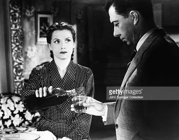 Actress Vera Clousot as Christina Delasalle with actor Paul Meurisse as her husband Michel Delasalle in the 1955 film Les Diaboliques