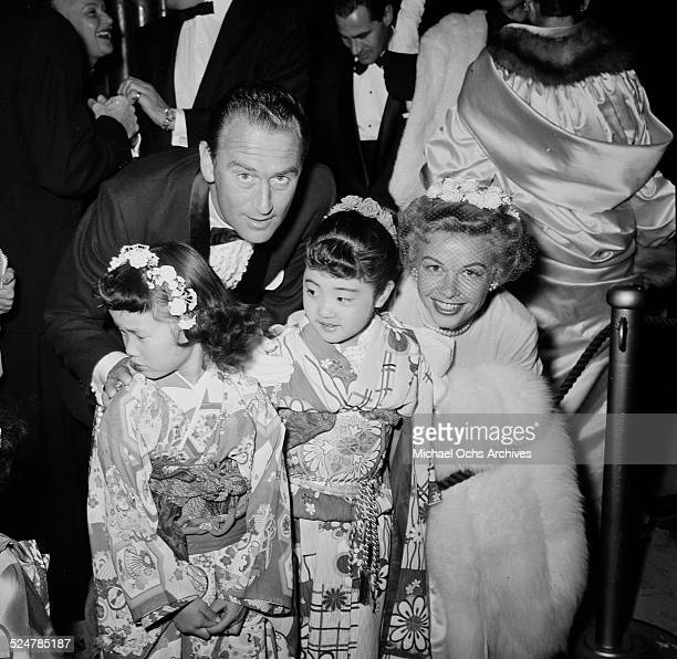 Actress VeraEllen and husband Victor Rothschild pose with two little girls as they attend a movie premiere in Los AngelesCA