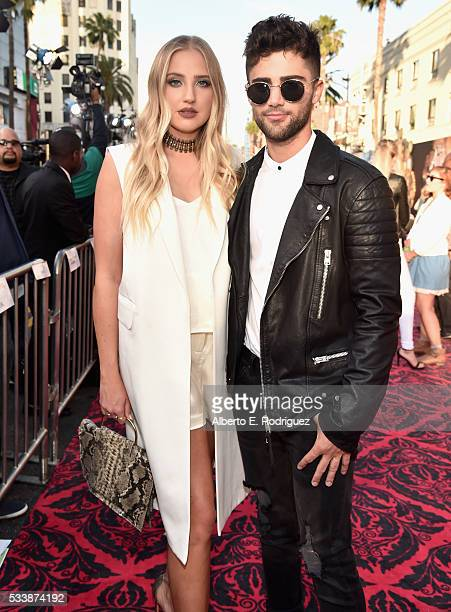 Actress Veronica Dunne and actor Max Ehrich attend Disney's 'Alice Through the Looking Glass' premiere with the cast of the film which included...