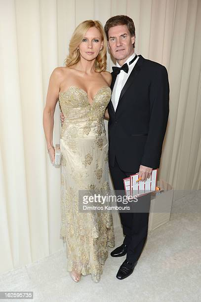 Actress Veronica Ferres and Carsten Maschmeyer attend the 21st Annual Elton John AIDS Foundation Academy Awards Viewing Party at West Hollywood Park...