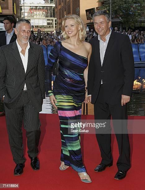 "Actress Veronica Ferres, Berlin mayor Klaus Wowereit and Wowereit's partner Joern Kubicki arrive for the German premiere of ""Poseidon"" July 11, 2006..."