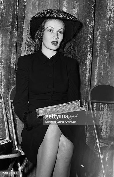 Actress Veronica Lake looks on as she sits alone in Los Angeles California