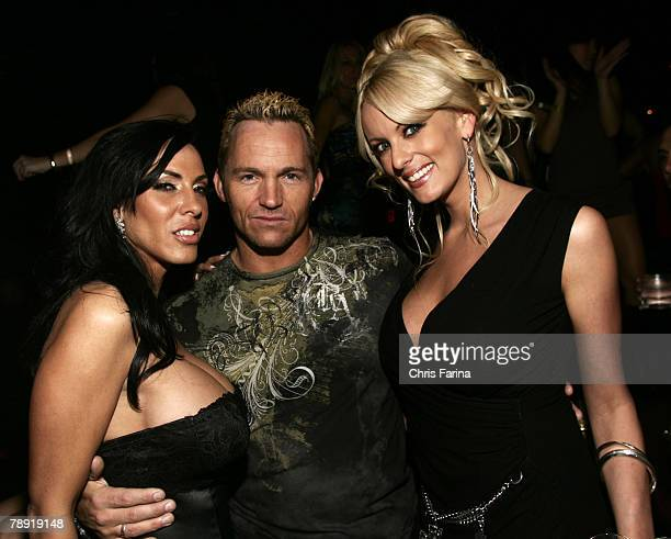 Actress Veronica Rayne actor Marcus London actress Stormy Daniels pose for photos at a naughty night to remember at TAO Nightclub at The Venetian...