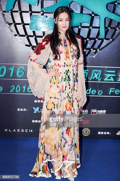 Actress Viann Zhang Xinyu poses at the carpet of the 2016 Mobile Video Festival at Beijing National Aquatics Center on December 25 2016 in Beijing...