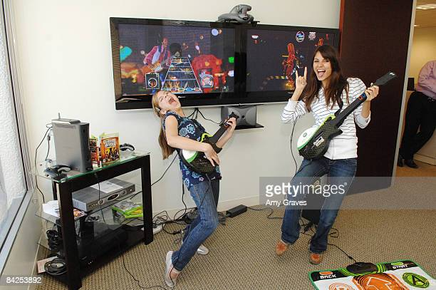 LOS ANGELES CA MARCH 28 Actress Victoria Justice and Aria Wallace pose for a photo with Guitar Hero III Legends of Rock at the XBox 360 Game with...