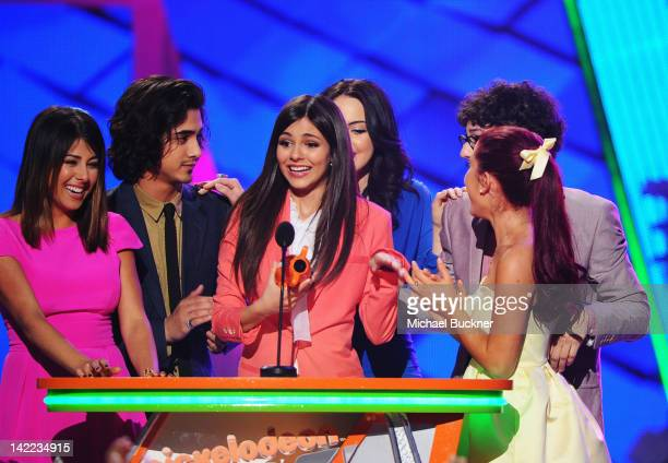 Actress Victoria Justice and fellow cast members from 'Victorious' speak onstage at Nickelodeon's 25th Annual Kids' Choice Awards held at Galen...