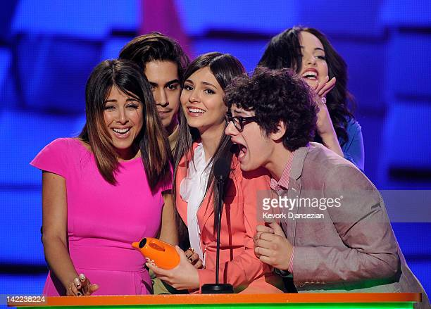 Actress Victoria Justice and fellow cast members from 'Victorious' onstage at Nickelodeon's 25th Annual Kids' Choice Awards held at Galen Center on...