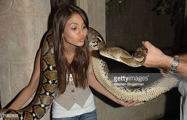 Actress Victoria Justice holds a Anaconda snake at the After Party forthe DVD Release 'Choose Your Own Adventure The Abominable Snowman' at the Star...
