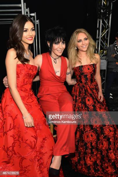 Actress Victoria Justice Joan Jett and Actress AnnaSophia Robb pose backstage at Go Red For Women The Heart Truth Red Dress Collection 2014 Show Made...
