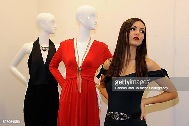 Actress Victoria Justice poses with mannequins during the Lord Taylor Stamford Grand ReOpening celebration on December 1 2016 at Lord Taylor Stamford...