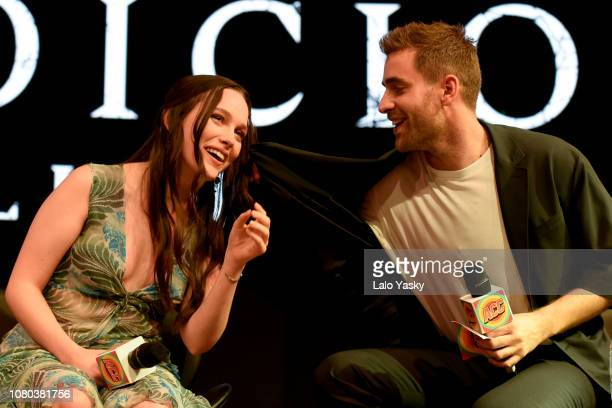 Actress Victoria Pedretti is helped by Oliver JacksonCohen after breaking into tears on stage during an interview during day 3 of Argentina Comic Con...