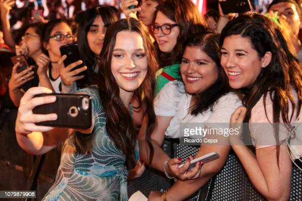 Actress Victoria Pedretti poses for selfies with fans after the The Haunting of Hill House panel during day 3 of Argentina Comic Con 2018 at Costa...