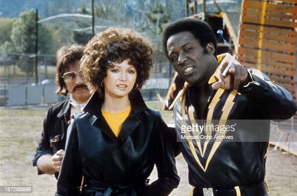 Actress Victoria Principal and actor Richard Roundtree on set for the movie 'Earthquake' Circa 1974