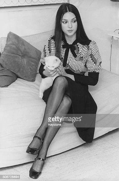Actress Victoria Principal who is accusing financier Bernard Cornfeld with assaulting her pictured holding a her pet kitten 'Matza' on her flat in...