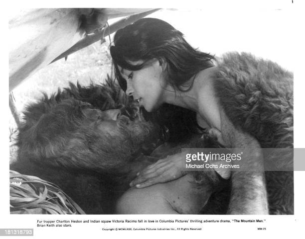 Actress Victoria Racimo and actor Charlton Heston on the set of Columbia Pictures movie 'The Mountain Men' in 1980
