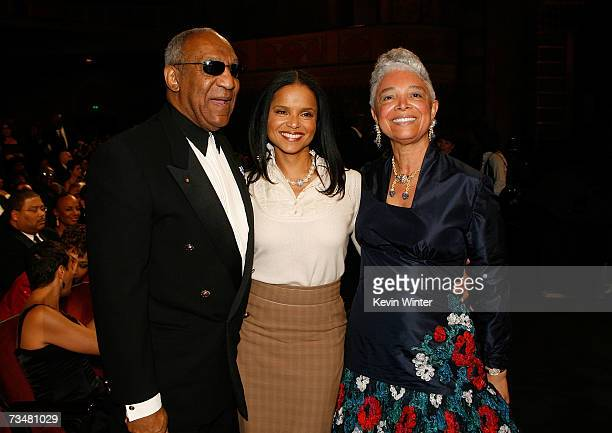 Actress Victoria Rowell comedian Bill Cosby and wife Camille O Cosby pose for photos in the audience during the 38th annual NAACP Image Awards held...