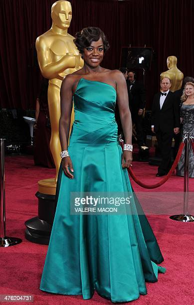 Actress Viola Davis arrives on the red carpet for the 86th Academy Awards on March 2nd 2014 in Hollywood California AFP PHOTO / VALERIE MACON