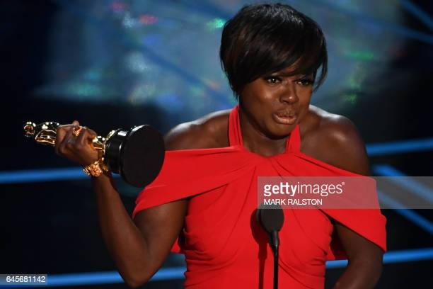 TOPSHOT US actress Viola Davis delivers a speech on stage after she won the award for Best Supporting Actress in 'Fences' at the 89th Oscars on...