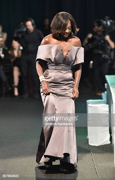 Actress Viola Davis heads to stage to accept the Outstanding Performance by a Female Actor in a Drama Series award for ' How to Get Away with Murder'...