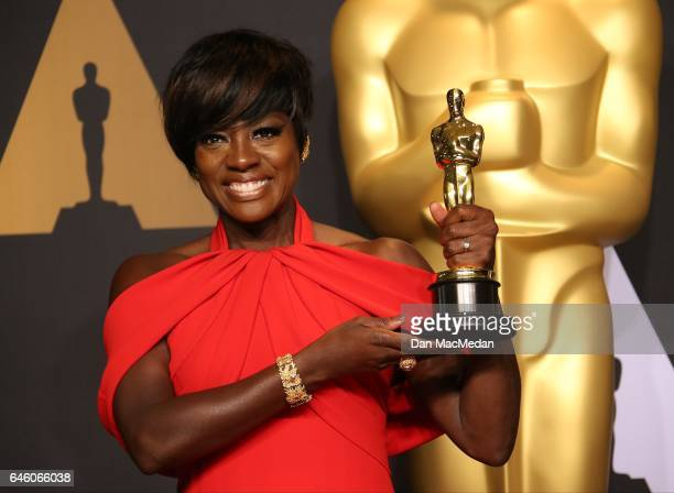Actress Viola Davis poses in the press room with the Oscar for Best Actress in a Supporting Role for 'Fences' at the 89th Annual Academy Awards at...