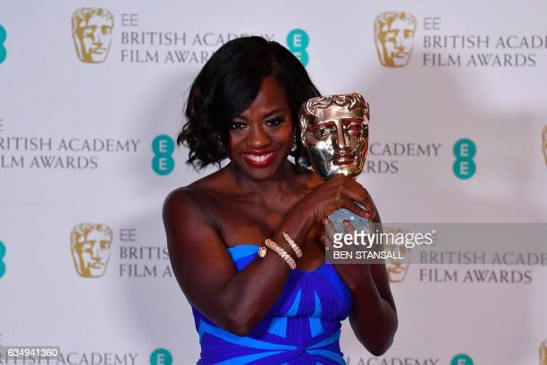 TOPSHOT US actress Viola Davis poses with the award for a Supporting Actress for her work on the film 'Fences' at the BAFTA British Academy Film...