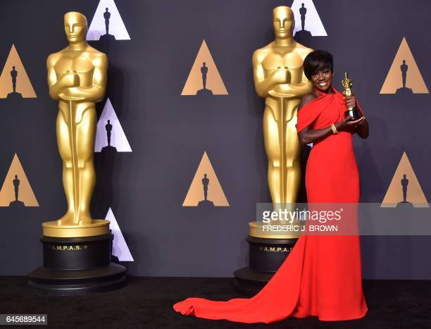 Actress Viola Davis poses with the Oscar for Best Actress in a Supporting Role in the press room during the 89th Oscars on February 26 in Hollywood...