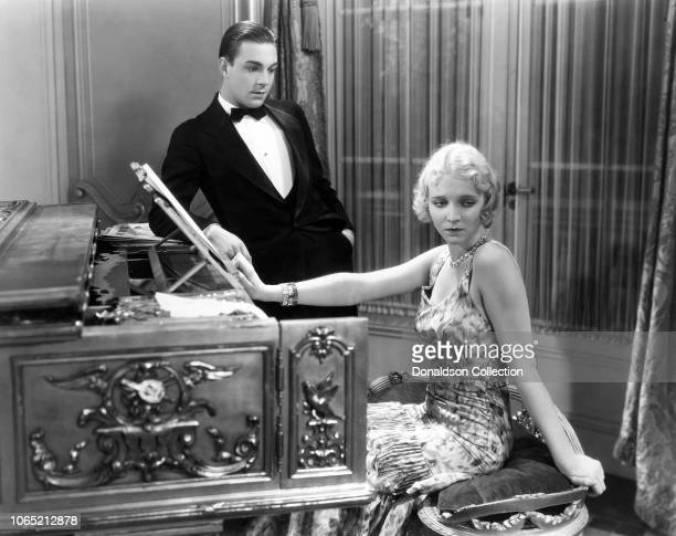Actress Virginia Bruce and Henry Wadsworth a scene from the movie Slightly Scarlet
