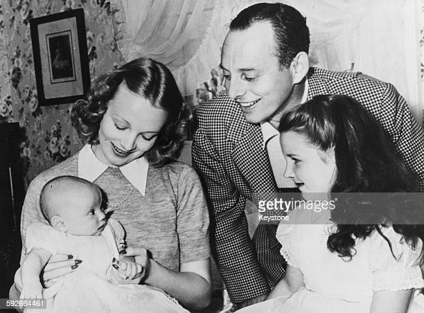 Actress Virginia Bruce and her husband screen writer J Walter Ruben pictured with their baby son Christopher and Wade's daughter Susan Gilbert...
