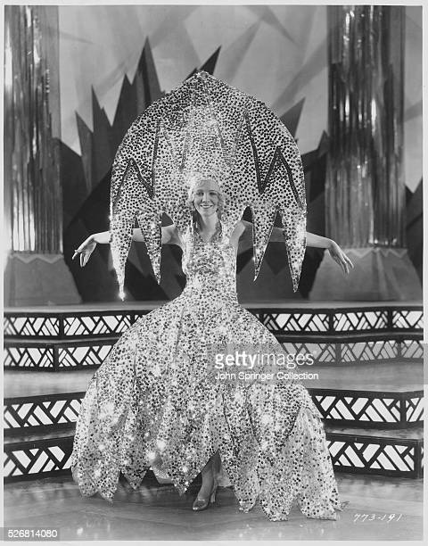 Actress Virginia Bruce wears an elaborate costume created of silver sequins The outfit was worn during a song and dance number in the starstudded...