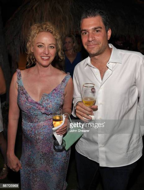 Actress Virginia Madsen and CAA's Christian Carino attend the Taste of Chocolate party at Four Seasons Resort Maui on June 19 2009 in Wailea Hawaii