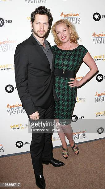 Actress Virginia Madsen and her guest attend the Premiere Of 'American Masters Inventing David Geffen' at The Writers Guild of America on November 13...