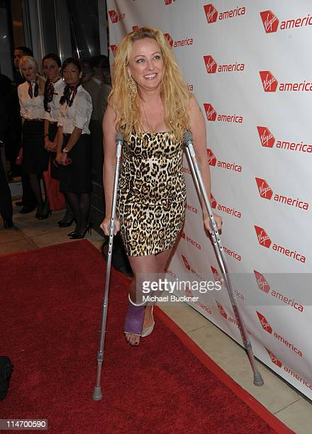 Actress Virginia Madsen attends the launch party for Virgin America's first flight from Los Angeles to Chicago on May 25 2011 in Chicago Illinois