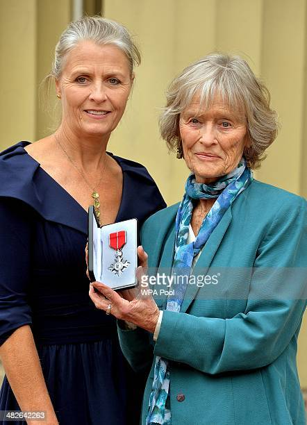 Actress Virginia McKenna poses with her daughter Louise as she holds the posthumous MBE awarded to her late husband Bill Travers after it was...