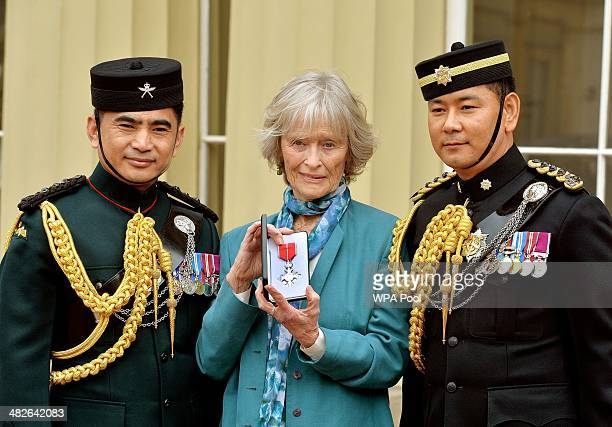 Actress Virginia McKenna with Gurkha Captains Suresh Thapa and Kumar Gurung holds the posthumous MBE awarded to her late husband Bill Travers who...
