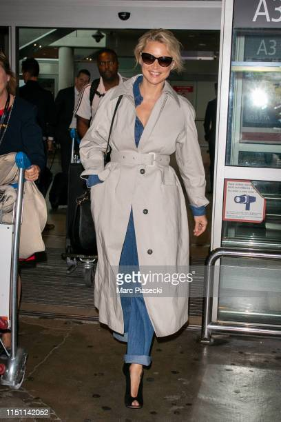 Actress Virginie Efira arrives ahead the 72nd annual Cannes Film Festival at Nice Airport on May 23 2019 in Nice France