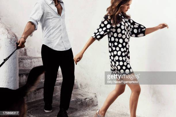 Actress Virginie Ledoyen is photographed for Madame Figaro on July 12, 2013 in San Valentino Torio, Italy. Dress , necklace , ring , shoes . Make-up...