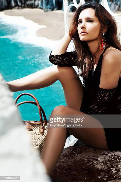 106843013 Actress Virginie Ledoyen is photographed for Madame Figaro on July 12 2013 in San Valentino Torio Italy Tunic swimsuit earrings necklace...