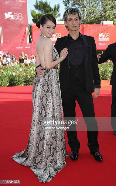 Actress Vivian Hsu and actor Ando Masanobu attend the Warriors Of The Rainbow Seediq Bale premiere at the Palazzo Del Cinema during the 68th Venice...