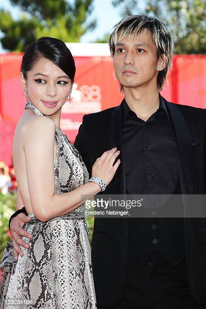 Actress Vivian Hsu and actor Ando Masanobu attends the Warriors Of The Rainbow Seediq Bale premiere at the Palazzo Del Cinema during the 68th Venice...