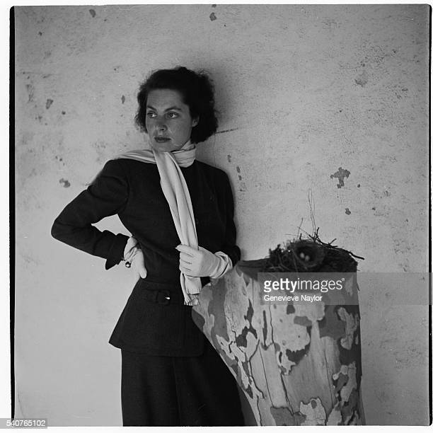 Actress Vivica Lindfors models a Forstmann wool suit and chamois Maximilian scarf for Harper's Bazaar Magazine New York City 1948