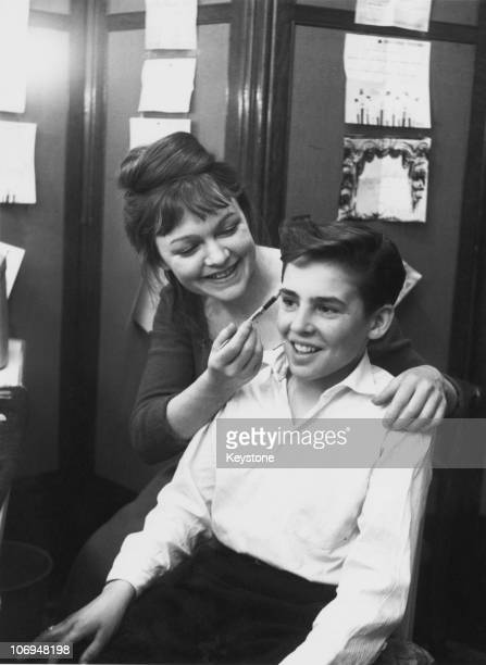 Actress Vivienne Martin helps child actor David Jones with his makeup backstage at at the New Theatre London 2nd May 1962 They are playing the roles...